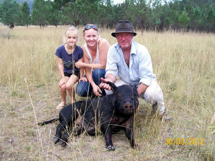 Sarah and Rod with an 80kgs sow